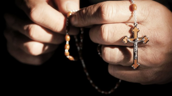 stock-footage-praying-hands-with-rosary-cross-closeup1-1024x576